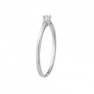 Bague solitaire Carador or blanc 375/000 et diamant 0.06 cts