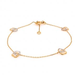 Bracelet en or jaune 750/000 maille forçat et ses cœurs CARADOR